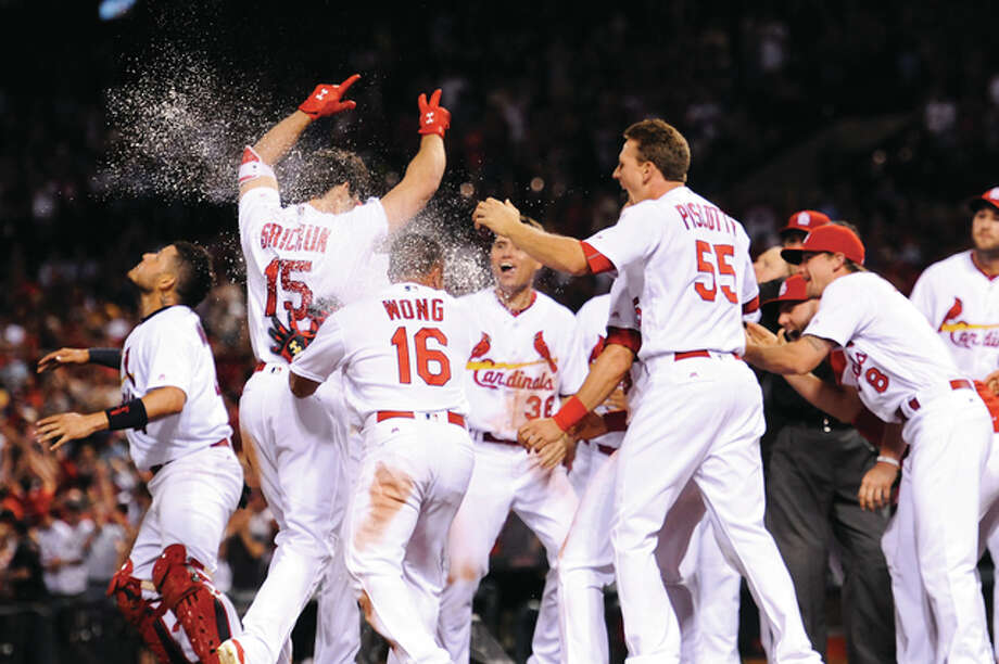 The Cardinals' Randal Grichuk (15) celebrates with teammates after hitting a walk-off home run in the ninth inning against the Chicago Cubs Monday in St. Louis. Photo: Michael Thomas | AP Photo