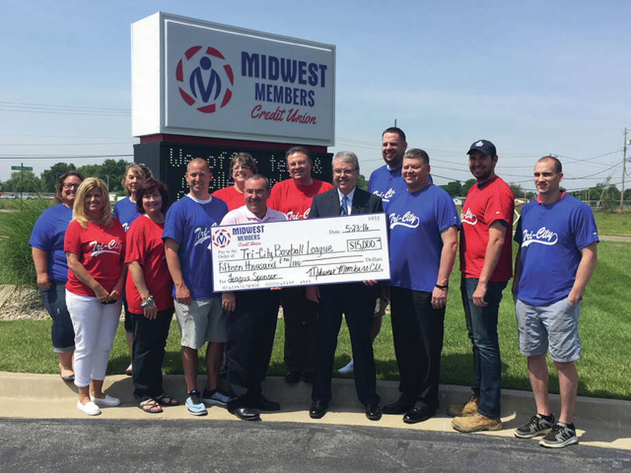 Midwest Members Credit Union president Greg Lyons, middle right, and senior vice president Lou Bicanic, middle left, present a $15,000 check to representatives from area communities including Wood River, East Alton and Roxana. The donation to the Tri-City Baseball/Softball League helped the league purchase equipment, jerseys and accessories for its participants.