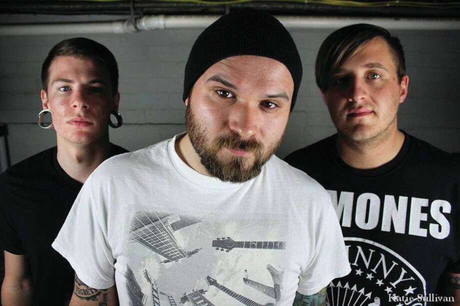"""River City Sound is made up of lead vocalist/guitarist Corey Johnson, 26, bassist Derek Spencer, 29, both of Alton, and drummer Sean Costin, 25, of Bethalto. The band will release its fourth EP, """"The Great American Flood,"""" with a show starting at 8 p.m., Saturday, May 28, at 300 State, Alton. Photo: Katie Sullivan Photography   For The Telegraph"""