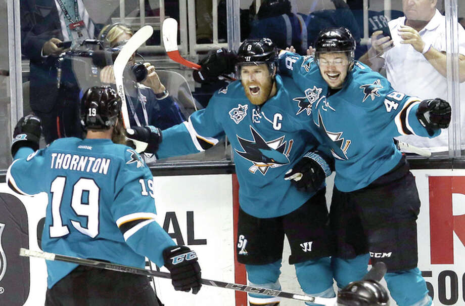 The Sharks' Joe Pavelski, center, celebrates his goal with teammates Tomas Hertl, right, and Joe Thornton (19) during the first period of Game 6 of Western Conference finals against the Blues Wednesday in San Jose, Calif. Photo: Jeff Chiu |AP Photo