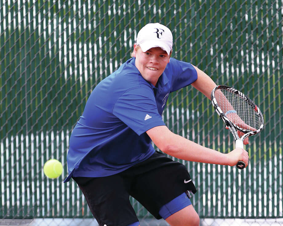 Marquette Catholic junior Jonathan Claywell, shown in a singles semifinal at last Saturdays sectional at Edwardsville, made his first state tournament appearance on Thursday in suburban Chicago. Photo: Billy Hurst / For The Telegraph
