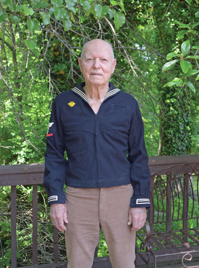 "Merle Inman in 2016, still able to wear the pullover ""jumper"" shirt of his dress blues. Photo: Vicki Bennington 