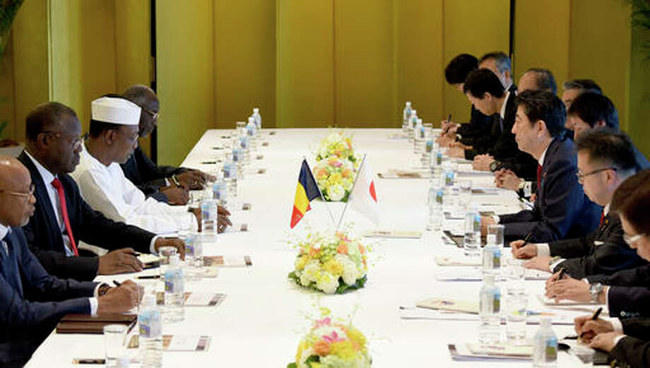 Chadian President Idriss Deby Itno, third left, speaks with Japanese Prime Minister Shinzo Abe, third right, during their talks in Nagoya, central Japan, Saturday.