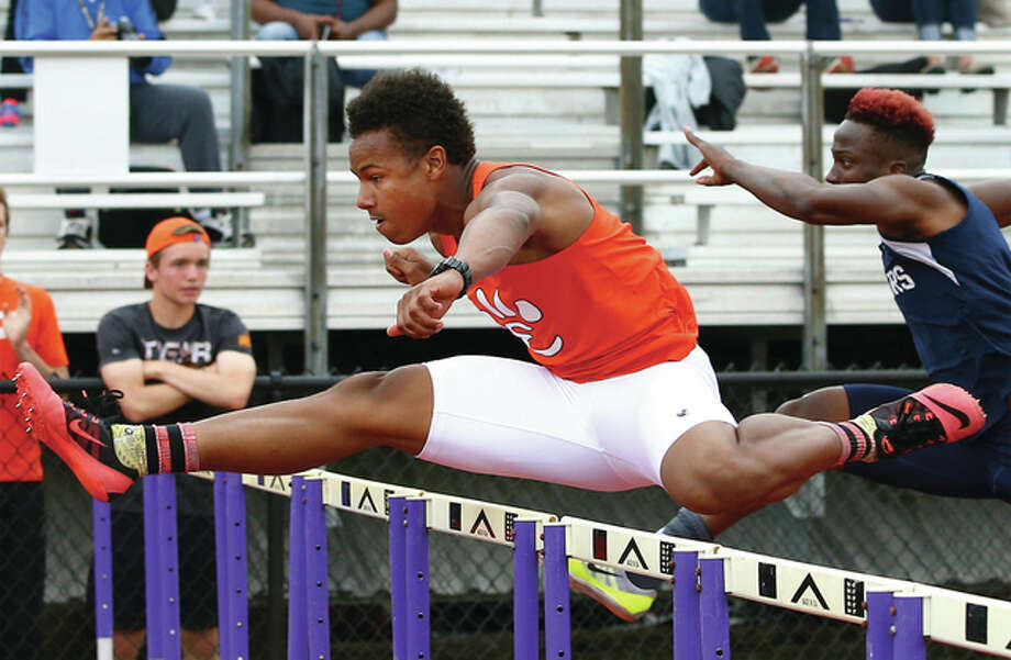 Edwardsville's Travis Anderson, shown while winning the 110-meter high hurdles during the Collinsville Class 3A Sectional meet May 20, won a Class 3A state title in the event Saturday at Eastern Illinois University in Charleston. Photo: Billy Hurst / For The Telegraph