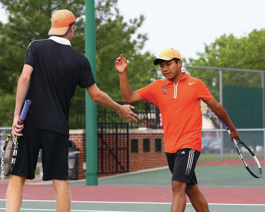 Edwardsville freshman Zach Trimpe (right) and sophomore Alex Gray celebrate a point during their title run at last weekend's Edwardsville sectional. After winning their first five matches at the IHSA state tournament, the Tigers doubles team finished off a fourth-place finish Saturday at Arlington Heights. After dropping a semifinal match in straight sets, Gray and Trimpe lost to Highland Park's David Aizenberg and Brandon Lew 7-6, 4-6, 6-2 in the third-place match. The fourth-place finish matches the best in Tigers history, equaling Cameron Randall and Justin Leskera's fourth-place doubles medal in 2012. Edwardsville placed eight as a team with 20 points. New Trier won the state title with 39 points. Photo: Billy Hurst / For The Telegraph