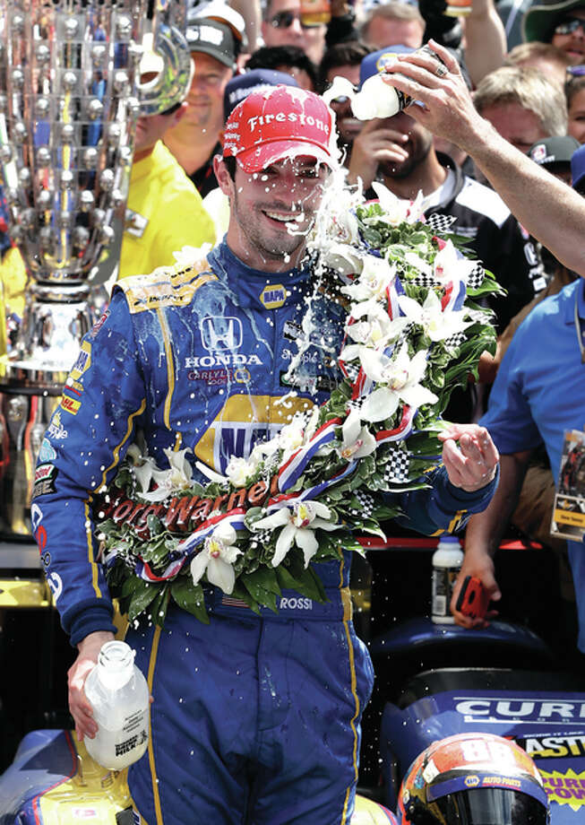 Alexander Rossi celebrates after winning the 100th running of the Indianapolis 500 on Sunday at Indianapolis Motor Speedway in Indianapolis. Photo: Associated Press