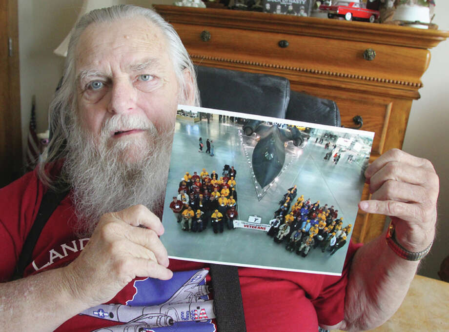 Richard Lee Carr, a Vietnam veteran and former prisoner of war, holds a photo of himself and a group of other veterans in front of an SR-71 Blackbird at the Smithsonian's National Air and Space Museum in Washington, D.C. Carr was among participants in a recent Honor Flight, a program that takes veterans to see memorials and other sites in Washington. Photo: Scott Cousins/The Telegraph