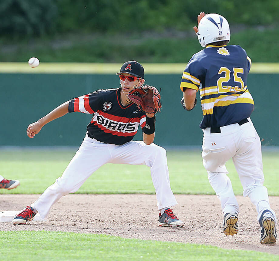 Alton's Rob Taul, left, waits for the ball as O'Fallon's Hayden Schaefer attempts a stolen base in Saturday's Class 4A regional championship. Taul tagged out Schaefer, but O'Fallon won the game 2-1. Photo: Billy Hurst | For The Telegraph