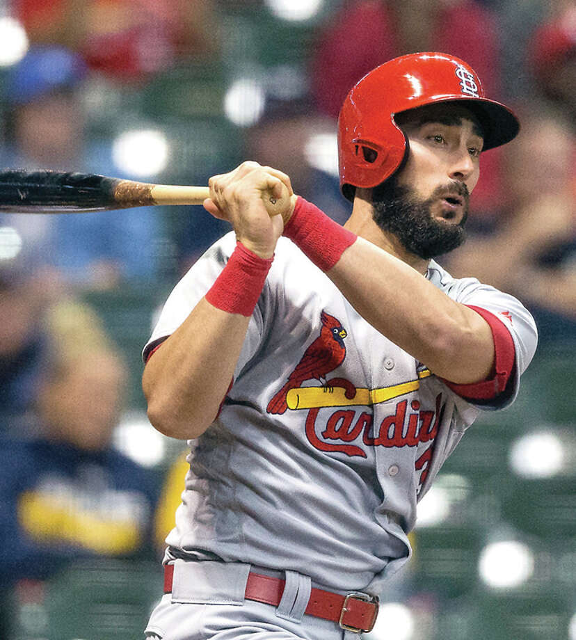 TheCardinals' Matt Carpenter follows through on a his fourth hit of the game and second triple off of Milwaukee Brewers' Jahn Mariz in the eighth inning Tuesday night in Milwaukee. Photo: Tom Lynn | AP Photo