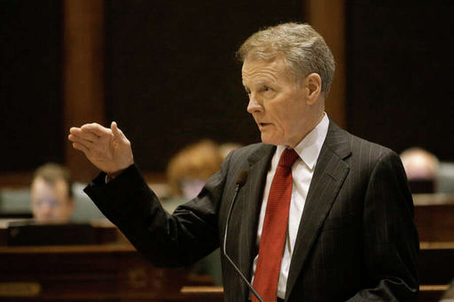 Illinois Speaker of the House Michael Madigan, D-Chicago, speaks to lawmakers while on the House floor during session at the Illinois State Capitol Tuesday, May 17, 2016, in Springfield, Ill. Illinois Gov. Bruce Rauner and legislative leaders met again to try to solve the state's budget impasse, but their vows to attempt to reach a compromise were tinged with skepticism from both sides. (AP Photo/Seth Perlman)