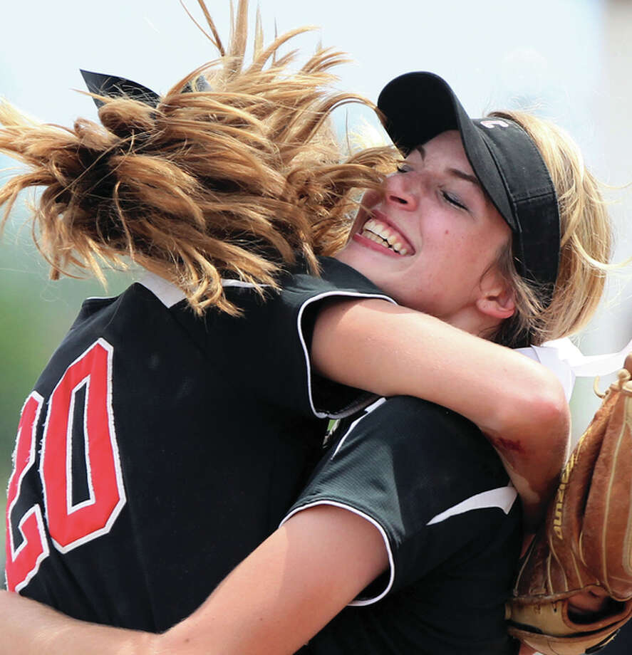 Calhoun's Grace Baalman (right) and Emma Baalman celebrate their team's Class 1A super-sectional victory over Casey-Westfield on Monday in Springfield. Calhoun won 1-0 in 13 innings, sending the defending state champion back to East Peoria for this weekend's state finals. Photo: Dennis Mathes / Journal-Courier