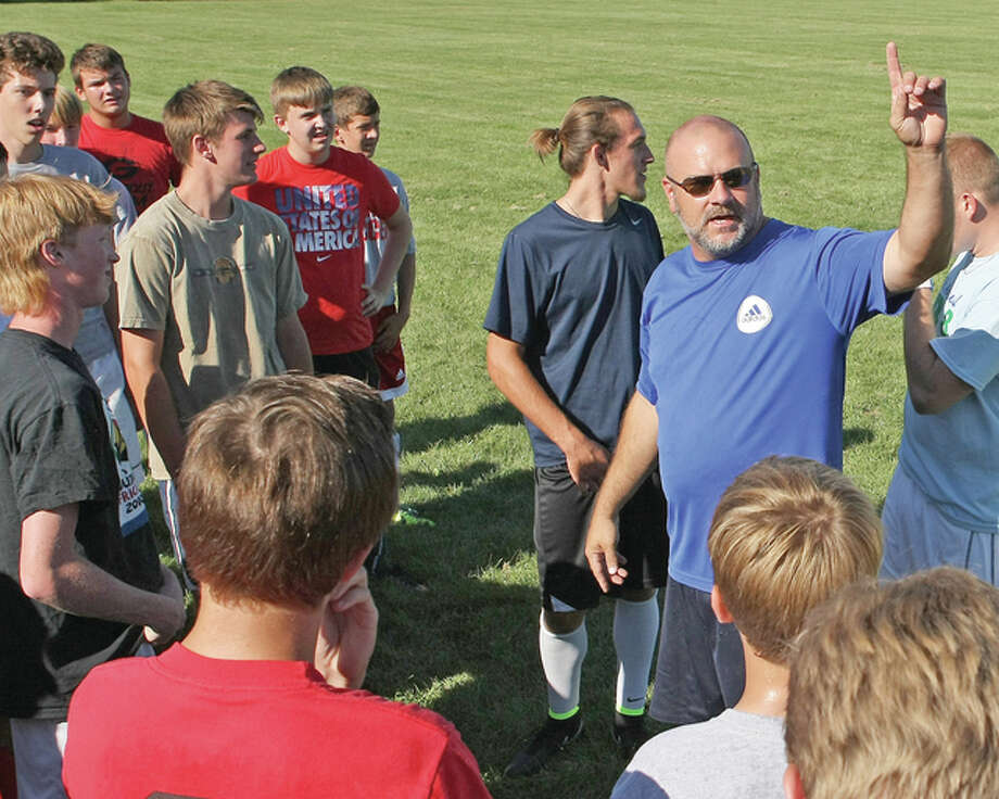 Former Alton boys soccer coach, Jay Robertson speaks with his players prior to a practice in preparation for the 2014 season. Robertson has resigned as boys soccer coach at AHS after six seasons. Photo: Billy Hurst File Photo | For The Telegraph