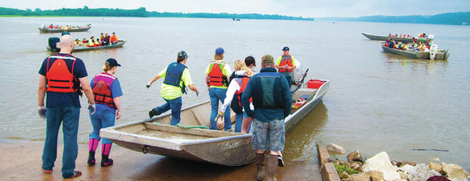 Living Lands and Waters founder Chad Pegracke gives out final instructions to the last set of clean-up volunteers before heading out with the other volunteer-filled boats, which traveled about one to two miles on the river from the Lincoln Shields Recreation Area in West Alton, Missouri. Photo: Dan Cruz | For The Telegraph