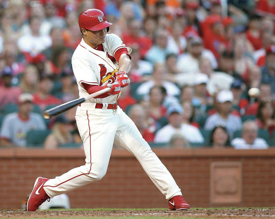 The Cardinals' Aledmys Diaz swings for a three-run home run during the fifth inning against the San Francisco Giants on Saturday night at Busch Stadium.