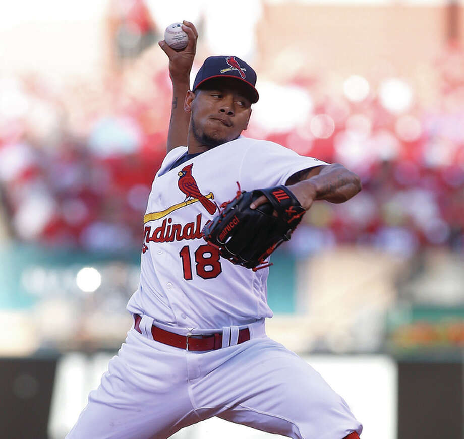 Cardinals starting pitcher Carlos Martinez pitches against the San Francisco Giants during the first inning Sunday night at Busch Stadium. Photo: Scott Kane / Associated Press