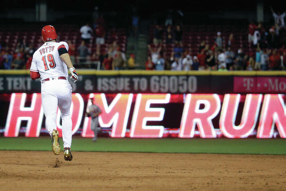 Cincinnati's Joey Votto rounds the bases after hitting a walkoff home run off Cardinals relief pitcher Kevin Siegrist in the ninth inning Tuesday night in Cincinnati. The Reds won 7-6. Photo: John Minchillo | AP Photo