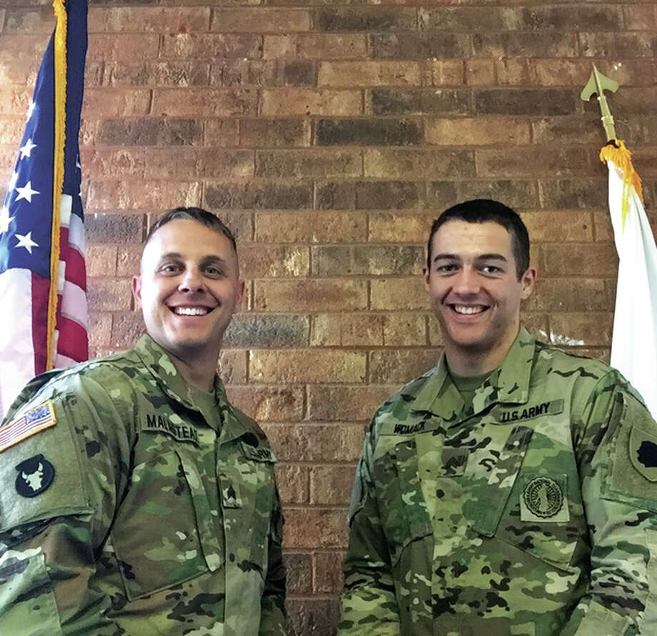Illinois National Guard Sergeants Eric Malmstead, left, and Anthony Womack, right, have recently been assigned to recruitment duty in the Metro East.