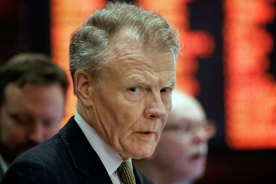"FILE - In this May 26, 2016 file photo, Illinois House Speaker Michael Madigan, D-Chicago, speaks to lawmakers while on the House floor at the state Capitol in Springfield, Ill. Gov. Bruce Rauner's Dudget Director Tim Nuding warned Friday, May 27, 2016 of ""devastating"" consequences if Illinois lawmakers don't agree on a spending plan for another year. House Speaker Michael Madigan said after Friday's meeting that the governor ""continues to fail to persuade"" lawmakers to agree to some of his priorities, such as reducing the cost to employers of workers' compensation insurance. (AP Photo/Seth Perlman, File)"