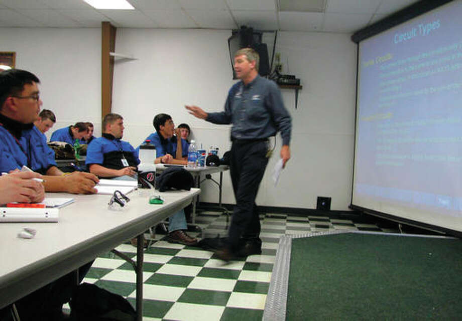 In this June 30, 2009 file photo, Larry Wostenberg teaches an engine management systems class at the WyoTech technical school, which was operated by Corinthian Colleges Inc, at their campus in Laramie, Wyo. Federal education officials are deciding whether to shut down the nation's biggest accreditor of for-profit colleges over allegations that it overlooked deception by its schools. The Accrediting Council for Independent Colleges and Schools is meant to be a watchdog for hundreds of for-profit schools, wielding the stamp of approval that colleges need to receive federal money. Institutions that have operated under the group's certification include the Corinthian College chain, which closed in 2015 amid fraud allegations, and the ITT Technical Institute chain, which now faces federal charges of fraud.