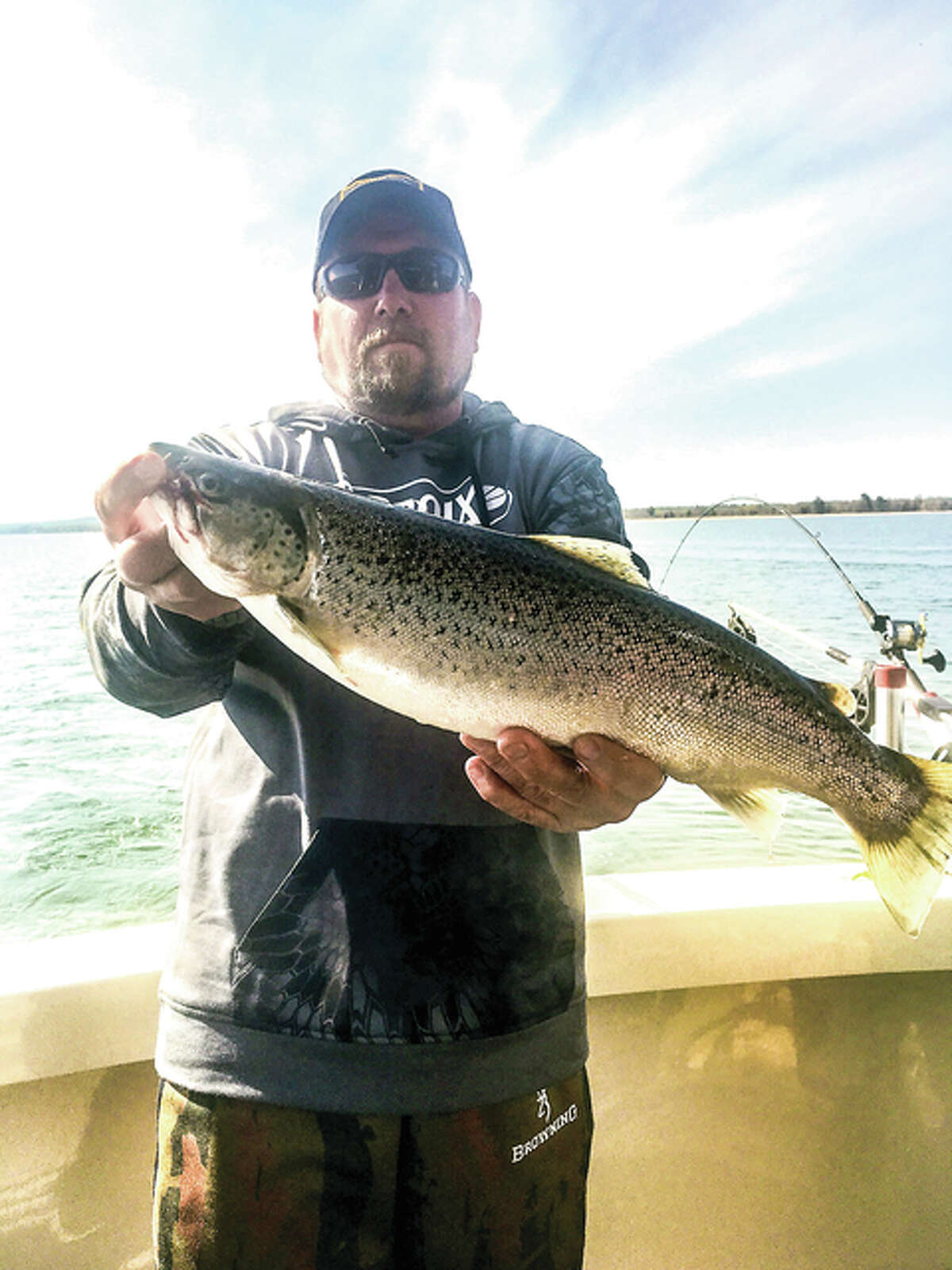 Association of Great Lakes Outdoor Writers President Jim Zaleski displays a hefty brown trout caught from Lake Superior.