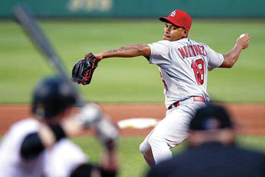 Cardinals pitcher Carlos Martinez delivers in the fifth inning Saturday night against the Pirates in Pittsburgh. Photo: AP