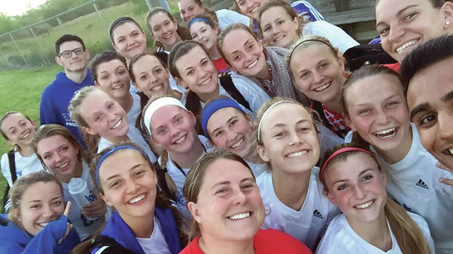 The Carlinville High School girls soccer team won the Illinois High School Soccer Coaches Association Section 12 Sportsmanship Award and was one of three finalists for the IHSSCA State Sportsmanship Cup. Above, the team poses for a 'selfie' following a regional tournament game. Head coach Ashley Hayes is front center and assistant coach Renee Young is upper right corner. Photo: Submitted Photo