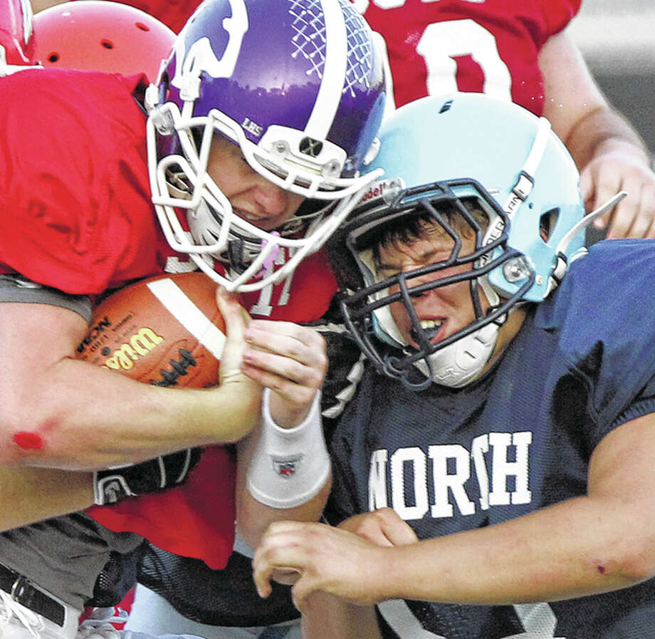 Triopia's Austin Holt of the North Squad slams into an opposing ball carrier late in the West Central Illinois All-Star Football Game in Springfield Saturday. Photo: Dennis Mathes, Journal-Courier | For The Telegraph