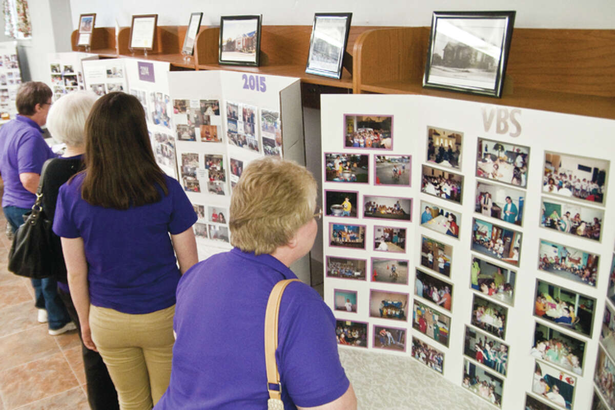 Centennial Celebration Committee members put together many photos on display for everyone to review and reflect on from the past up to the current time of day.