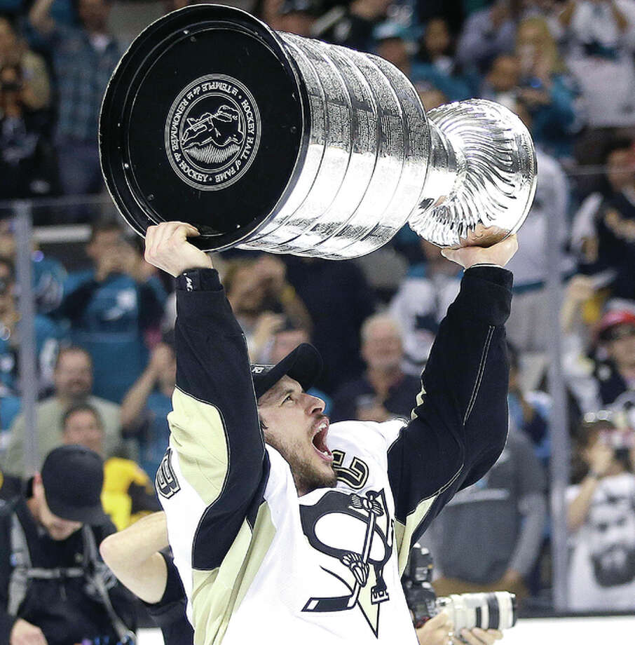 Pittsburgh Penguins center Sidney Crosby celebrates with the Stanley Cup after beating San Jose 3-1 in Game 6 of the Stanley Cup Finals to win the series 4-2. Photo: Marcio Jose Sanchez | AP Photo