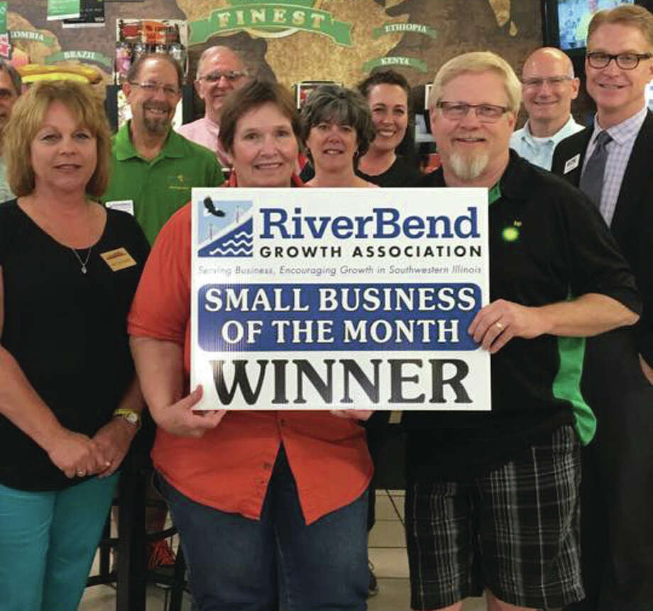 Owners Jim and Patty Eppel pose with members of the RiverBend Growth Association. Their business, Eppel's Pantry and Deli, won the association's Business of the Month award in June.