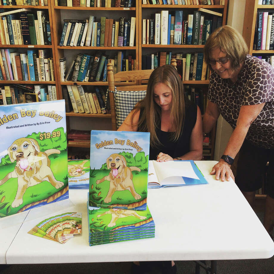 Author Erin Frew, seated, at a recent book signing held at Second Reading Book Shop on E. Broadway in Alton. This is her first children's book.