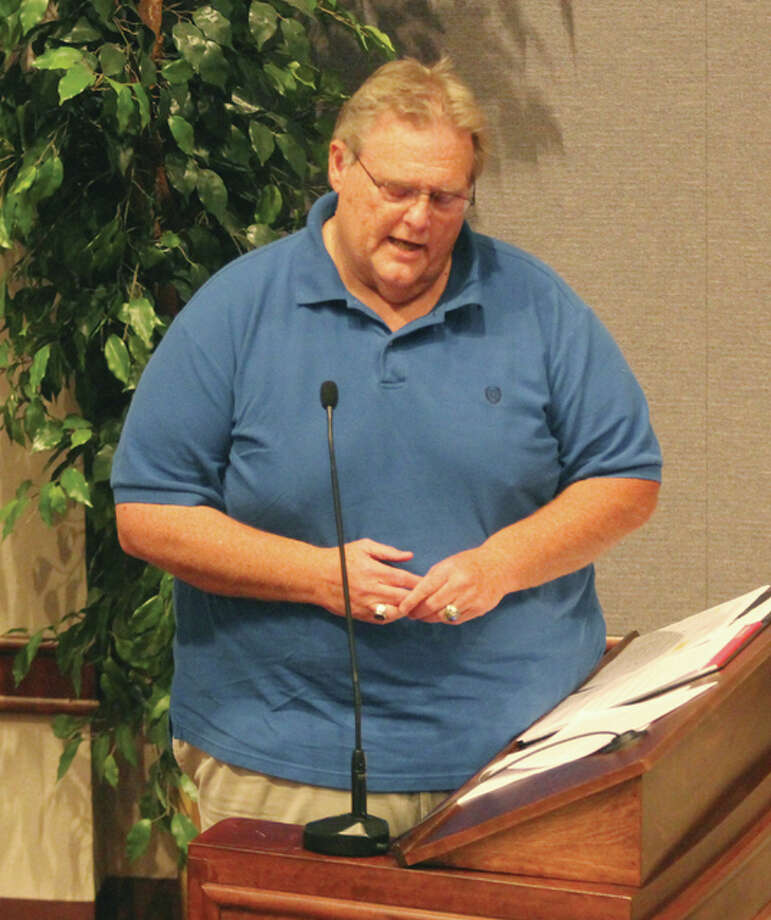 Chuck Johansen, representing supporters of school consolidation between the EAWR, Wood River-Hartford Elementary and East Alton Elementary school districts, speaks at a public hearing Monday in Edwardsville. A petition seeking a November referendum on consolidation has been filed and is being considered by the Madison County Regional Superintendent of Schools Robert Daiber.