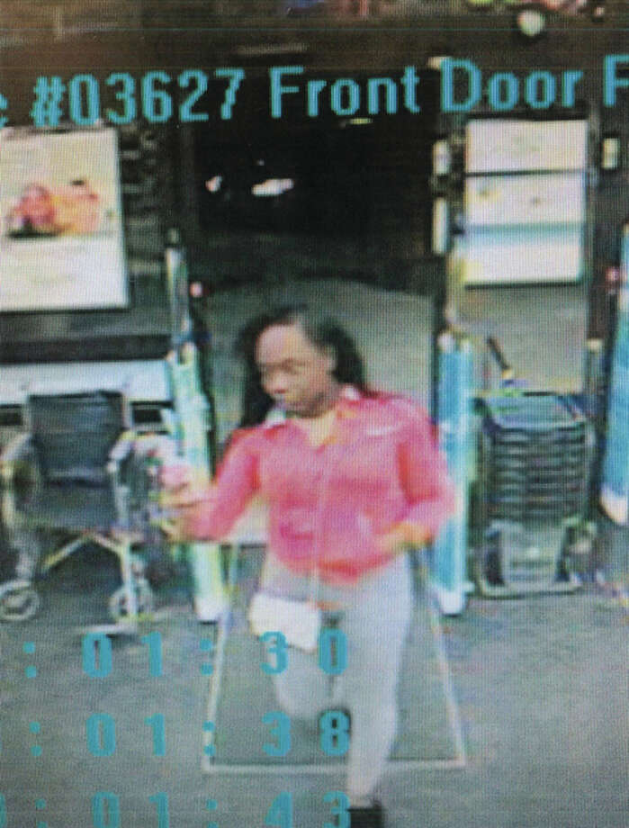 Surveillance photo of the woman allegedly using a stolen credit card at area businesses.