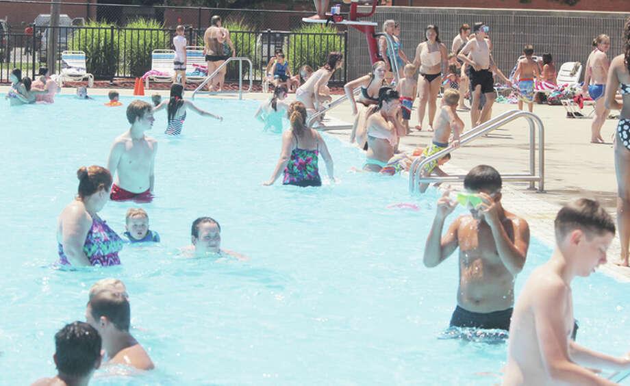 People crowd the pool at the Wood River Aquatic Center Wednesday afternoon. Large crowds have made this the best year ever for the center, which could more than double last year's attendance.