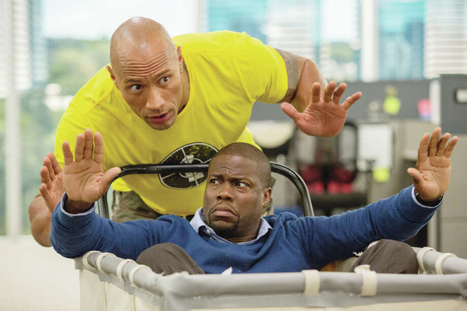 "This image released by Warner Bros. Entertainment shows Kevin Hart, bottom, and Dwayne Johnson in a scene from, ""Central Intelligence."" (Claire Folger/Warner Bros. Entertainment Inc. via AP)"