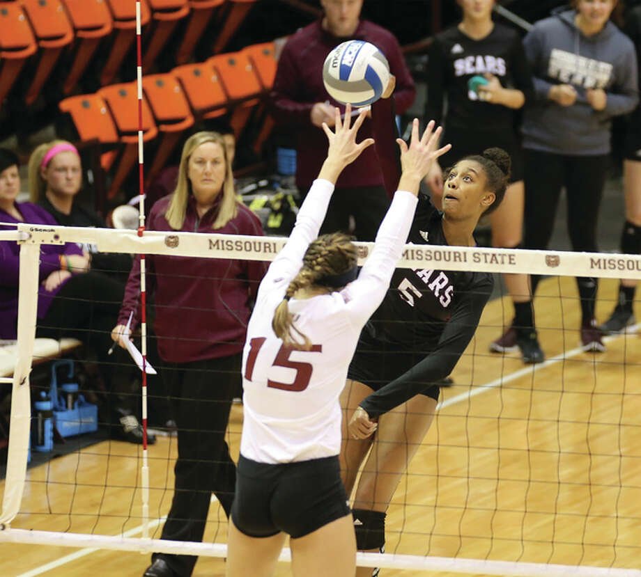 Missouri State's Lynsey Wright (right) hits over the block during a Bears match at Hammons Student Center last season in Springfield, Mo. Wright, a 6-foot middle blocker from Glen Carbon, will compete with the U.S. Collegiate National Team-Indianapolis program June 21-30 in Indianapolis. Photo: Missouri State Photographic Services