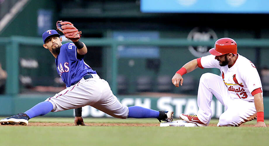 St. Louis Cardinals' Matt Carpenter, right, is forced out at second by Texas Rangers second baseman Rougned Odor during the fourth inning of a baseball game Friday, June 17, 2016, in St. Louis. (AP Photo/Jeff Roberson) Photo: Jeff Roberson | AP Photo