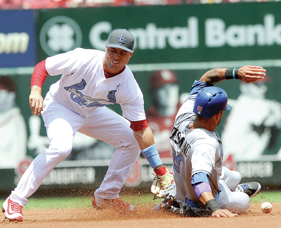 The Texas Rangers' Ian Desmond, right, steals second as the ball gets away from the Cardinals' Aledmys Diaz Sunday at Busch Stadium in St. Louis. Photo: Bill Boyce | AP Photo