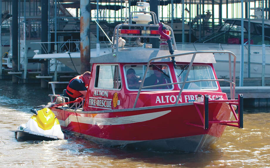 Alton Fire and Rescue personnel hauled in a jet ski owned by River Road Watersports Jet Ski Rentals after an individual who rented the jet ski fell off of it Sunday when he hit a log floating in the Mississippi River near the Melvin Price Alton Lock and Dam 26 just before 2 p.m., Alton Fire Chief Bernie Sebold said.