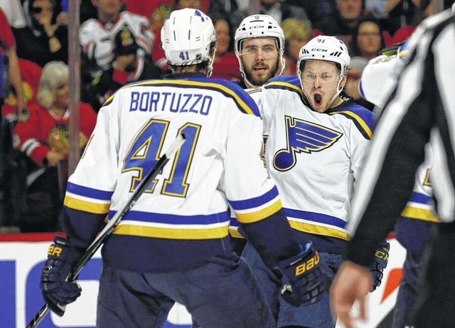The Blues will open the 2016-17 season on the road Oct. 12 at Chicago and will open their 50th home season Oct. 13 against the Minnesota Wild. Above, the Blues right wing Vladimir Tarasenko, right, celebrates a goal against the Blackhawks during last season's playoffs. Photo: AP File Photo