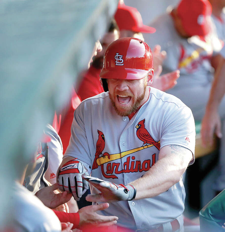 The Cardinals' Brandon Moss celebrates in the dugout after his home run off Cubs starting pitcher John Lackey in the second inning Monday in Chicago. Photo: Charles Rex Arbogast   AP Photo