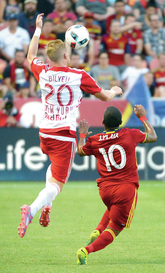 New York Red Bulls defender Justin Bilyeu (20) leaps over Real Salt Lake forward Joao Plata (10) as he heads the ball upfield during an MLS soccer game Wednesday, June 22, 2016, in Sandy, Utah. (Steve Griffin/The Salt Lake Tribune via AP) Photo: Steve Griffin, The Salt Lake Tribune Via AP