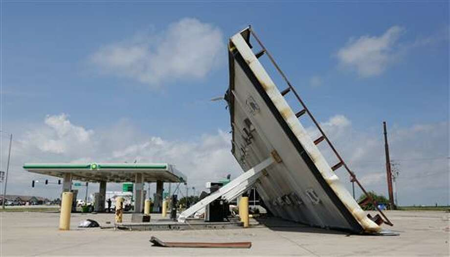 A gas station canopy lays on its side Thursday in Pontiac after it was damaged Wednesday night by a tornado. The tornado that cut a more than 11-mile path through the Pontiac area was rated an EF-2 with estimated top wind speeds of 115 to 125 mph.