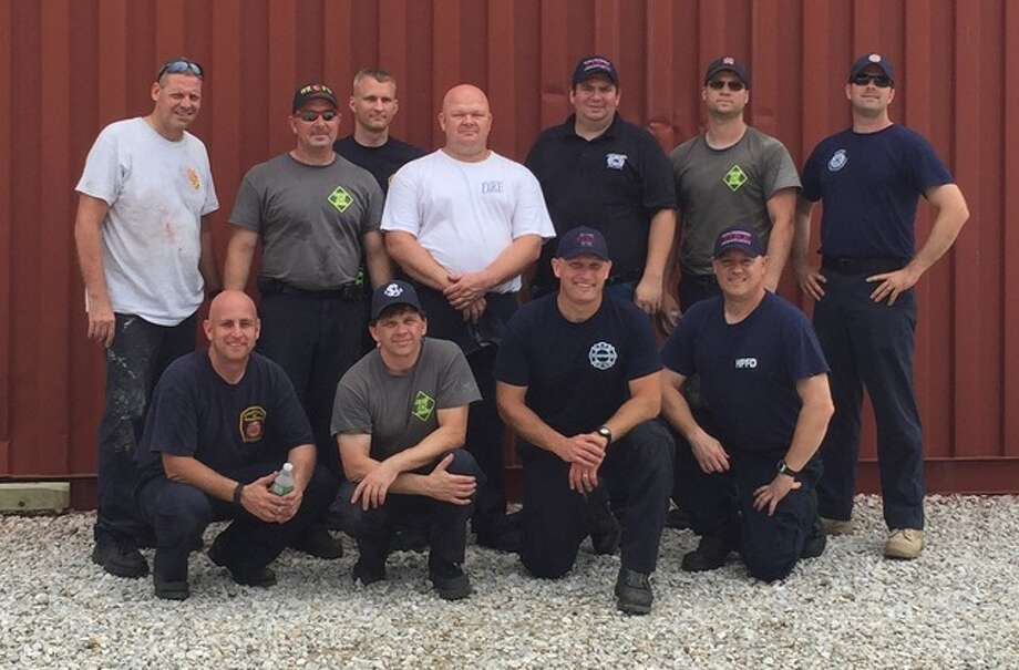 Firefighters from Mutual Aid Box Alarm System Division 35 of Madison County participated in the Prairie Dragon rescue drill in Quincy this week, representing seven area fire departments. Photo submitted by Chief Bernie Sebold of the Alton Fire Department.
