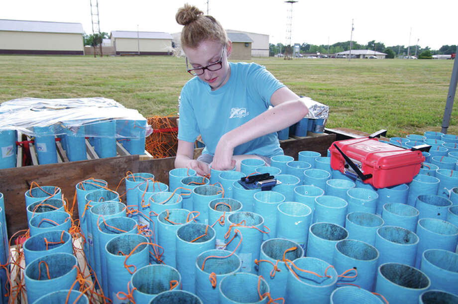 API ARC Pyrotechnics Inc. crew member Sarah Chabot prepares fireworks shells for Sunday night's display at the Cornerstone Church celebration at the St. Louis Regional Airport in East Alton. Photo: David Blanchette|For The Telegraph