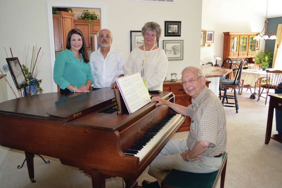 Ken Conrady, Alton Youth Symphony co-founder and board member, seated at piano, and standing, from left, Abigail Knoche, director of AYS, Joe Cacciottoli, president of AYS board of directors, and Elizabeth Jankowski, director of the Alton Junior Youth Symphony. Photo: Vicki Bennington/For The Telegraph