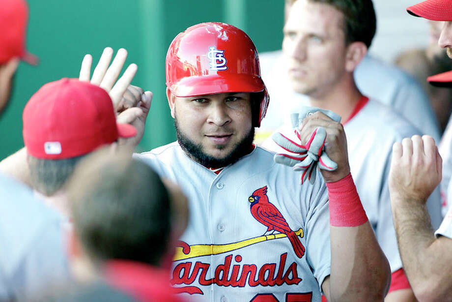 The Cardinals' Jhonny Peralta is congratulated in the dugout after scoring in the second inning of Tuesday's game against the Royals in Kansas City, Mo.