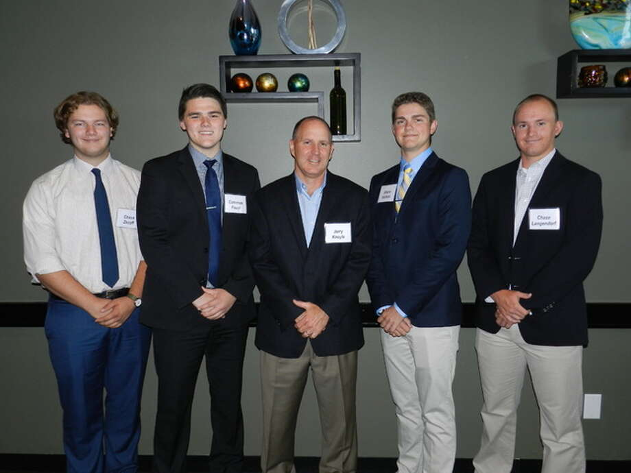 Wood River Refinery manager Jerry Knoyle, center, stands with scholarship recipients, from left, Chase Zezoff, Cameron Foust, Shane Nichols and Chase Langendorf.