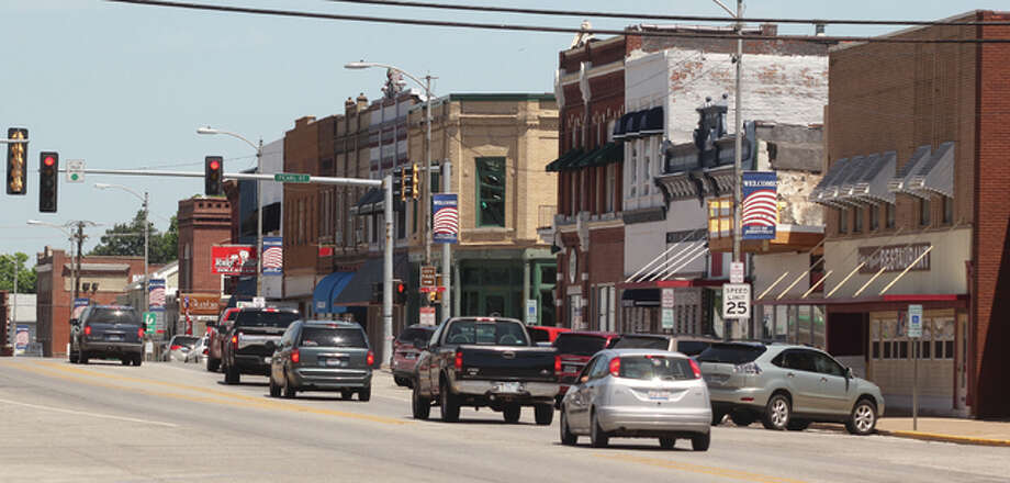 A line of cars drives down State Street in Jerseyville. Mayor Bill Russell says the town is primed for economic development.