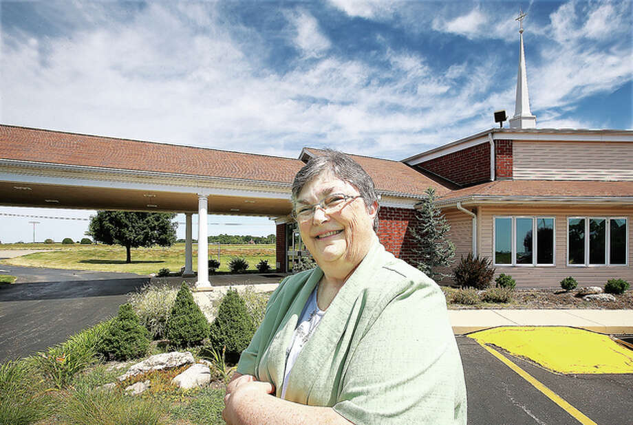 Rev. Pamela S. Laing stands in front of the United Presbyterian Church, 2550 E. Rock Road in Wood River on Wednesday. Laing is leaving the church and will be honored at a reception July 10.